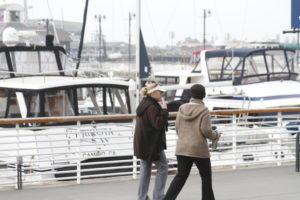 ali & joie walk along harbor